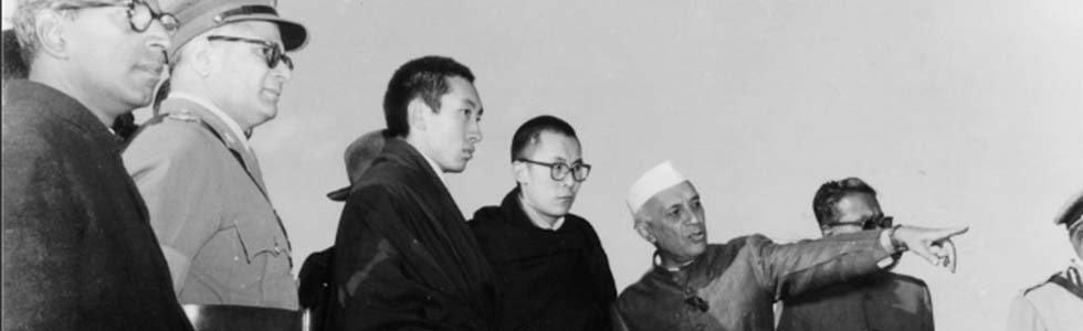 Prime Minister Jawahahrlal Nehru pointing out a landmark to H.H: the Dalai Lama and Panchen Rinpoche, 1957