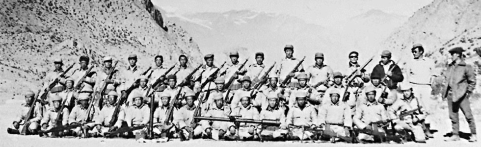 Tibetan Resistance fighters pose with weapons following CIA arms drop