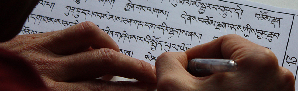 Monk writing the Sangháta Sutra